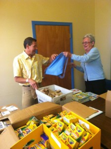 Bev and Steve from Windermere stuffing pre-k backpacks