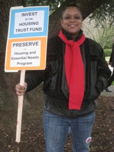 "A seasoned advocate from Rose of Lima House with her sign just before the ""Homes for All"" rally on the Capitol steps!"